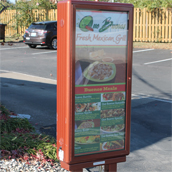 Que Bueno's Fresh Mexican Grill exterior pre-sell board