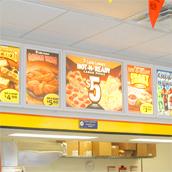 Little Caesar's Pizza interior illuminated menu boards